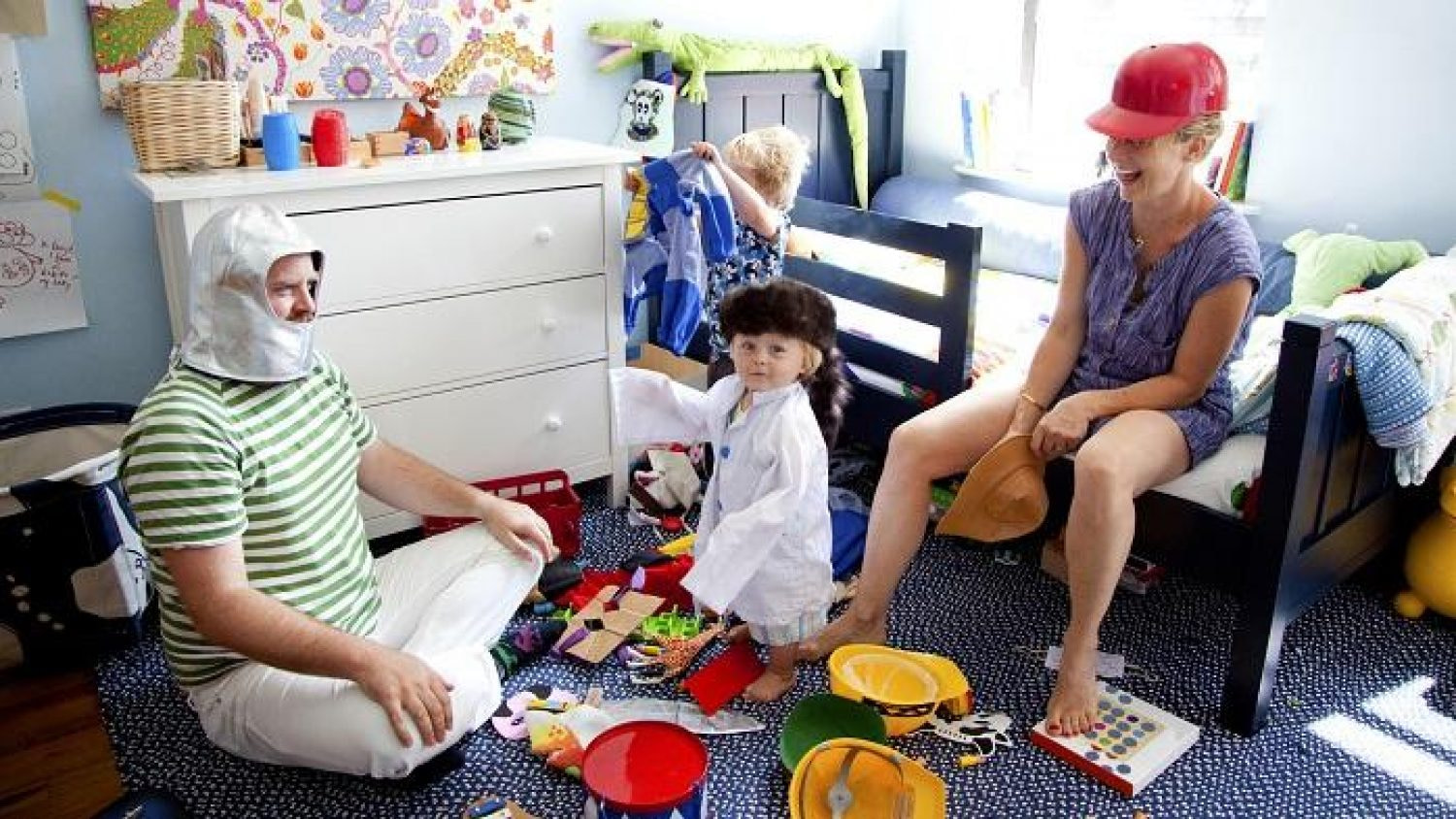 Parents Playing Dress Up With Their Two Sons.